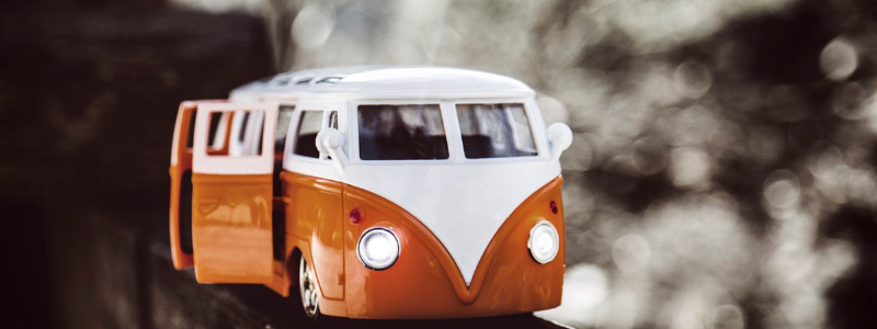 An orange and white camper van